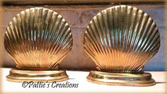 I bought these brass sea shell book ends at a thrift store and painted them white. This is the before photo. I am having so much fun re doing items for my next house.