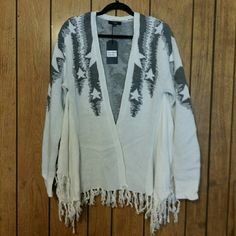 Sweater/wrap nwot Beautiful ivory and gray sweater or wrap. Open front with draped sides and knotted fringe all around edges. It's a blend of cotton, nylon and 13% angora, making this so soft and cozy, thicker weight and very warm. Size L, but could fit multiple sizes, and brand new. Throw this on and go, looking fabulous!!! Very J Sweaters Shrugs & Ponchos