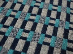 """Close up of """"Paperchain"""" woven lambswool cloth in the """"Sea"""" colourway by Heather Shields"""