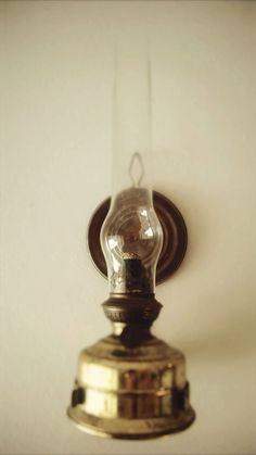 Old oil lamp. Early 1900's.