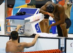 Cullen Jones of Team USA reacts after Ryan Lochte (left) finished second in the final leg of the men's 400m freestyle finals during the London 2012 Olympic Games. (US Presswire Photo / July 29, 2012)