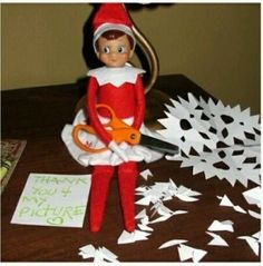 Elf on the Shelf Idea:  Making Paper Snowflakes by summer