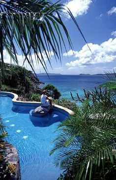 Virgin Islands. I'm imagining myself sitting at that rock instead of that lucky lady in the picture!