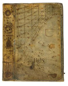 This scientific book from 1678 has an amazing cover. The front of the sheepskin bookbinding is not filled with blind-stamped decoration, as was often the case, but a printed sundial was pasted on it. Put the book in the sun, place a stylus on the cover, and it will tell you what time it is. What's more, it was likely used in this fashion given that the 'footprint' of the stylus is still visible - note the small circle and the black stain near the letters IHS