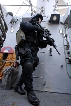 PACIFIC OCEAN (Aug. 18, 2008) A member of the Brunei Special Forces rushes towards the pilot house of the Arleigh Burke-class guided-missile destroyer USS Howard (DDG 83) during a visit, board, search and seizure exercise. Howard, along with the Brunei Air Force and Royal Brunei Navy, are participating in South East Asia Cooperation Against Terrorism exercises off the coast of Brunei. Howard and the Ronald Reagan Carrier Strike Group are on a scheduled deployment in the U.S. 7th Fleet...