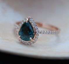 Rose Gold Engagement Ring Peacock Blue Green Sapphire pear cut halo engagement…