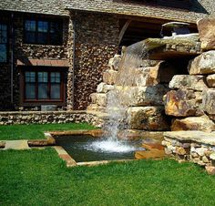 Sometimes when we think waterfall, we have in our minds something we can look up at, not down upon. Most of us cannot fathom having anything more than a simple garden waterfall to bring the sound of moving water to our outdoor living areas, but if you can, go big. Stacked rocks and elaborate planning went into this gorgeous design that truly defines the meaning of waterfall.