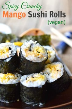 Spicy Crunchy Mango Sushi Rolls - it's easy to make these healthy and delicious vegan sushi rolls. Make a big batch for dinner and take the leftovers for lunch! A great recipe for your vegetarian friends.