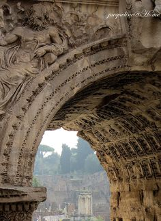 "The ruins of the ""Old City"" in Rome, this is the arch of Constantine. The arch is made from stone and featured the gods and victorious campaigns"