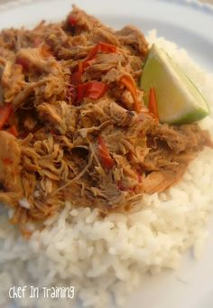 Slow Cooker Thai Pork with Peanut Sauce | • 2 pounds boneless pork loin, fat trimmed and cut into 4 pieces • 2 red bell peppers, cut into strips • 1/2 cup prepared Teriyaki sauce • 2 Tbsp. rice vinegar • 1 tsp. red pepper flakes3 cloves garlic • 2-3 Tbsp. creamy peanut butter • Optional garnishes: Chopped green onions (about 1/2 cup), roasted chop peanuts (about 1/4 cup),1 lime sliced into wedges