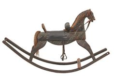 "FOLK ART ROCKING HORSE - Early 19th c. New England Estimated Price: $800 - $1,200 Description: FOLK ART ROCKING HORSE - Early 19th c. New England Carved Pine Rocking Horse in spattered casein paint finish, with leather harness, real horsehair tail, later oil cloth saddle covering, having very long bentwood runners. 29 1/2"" x 50"" x 14"". Fabulous age and use patina."