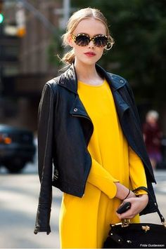 Don't be afraid to team something bold with something delicate. Case in point, a black leather jacket with a floaty yellow dress!