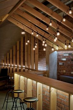 Ravishing ATTIC Bar Blends Rustic Textures With Contemporary Design