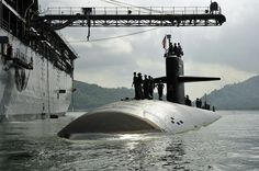 USS Louisville (SSN 724) moors alongside the submarine tender USS Emory S. Land (AS 39) by AN HONORABLE GERMAN, via Flickr