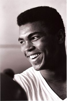 This is how I'll always remember Muhammad Ali, young, brash, smiling and with a whole universe of merriment and deviltry in those ever expressive eyes. Before the war took from him his best years. Before Joe Frazier, in righteous fury, won a epic...