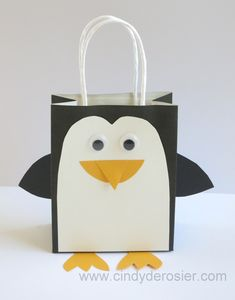Turn a black gift bag into the cutest little penguin! It's so easy to do and makes the present extra …