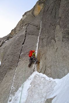 Ben Guigonnet with rock shoes and ice axes! On the crux rock pitch of the Gabarrou Silvy on the Sans Nom