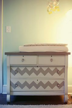 painted furniture...if a girl's nursery maybe dark blue with gold chevron or fucshia? If a boy then red with yellow