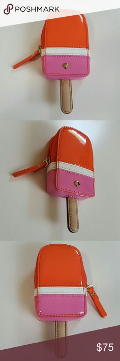 """Kate Spade Strawberry Popsicle Coin Purse This lovely coin purse is from Kate Spade New York and is a stripped red, white, and pink Strawberry Popsicle Coin Purse with brown stick. Detailed leather with silver stud spade on the front. This is in like new perfect condition. Great icecream summer fun themed accessory perfect with your favorite shirt and jeans. Other great accessories in my closet. 6"""" long 2 1/2"""" wide and 1"""" thick. kate spade Bags Wallets"""