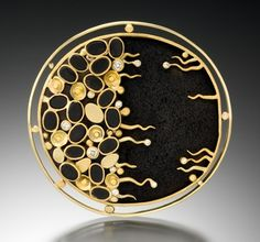 Brooch by Judith Kaufman. 18k green gold, 22k yellow gold, black onyx, lava rock and diamonds