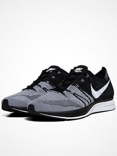 Nike's hugely revered Flyknit Trainer+ runner was designed based on insights from the world's best marathon runners. Like the Nike Flyknit Racer, it features a virtually seamless knit upper for targeted support, breathability and a snug fit. Knitted Nylon Uppers  Adaptive Flywire Construction  Zoom Cushioning  Waffleskin Outsole  Reflective Panels for Low-Light Running  Style Code: 532984-010