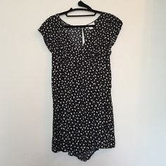 Romper Black and white romper with flower detail. Great for spring! Never worn, but no tags attached. Forever 21 Dresses