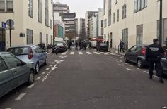 Shooting in France kills 11!! Police and rescue services near the office of Charlie Hebdo in Paris, 7 January 2015