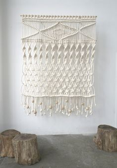 sally england macrame hangings...i'm in love!!!  I want one for a headboard and one for a room divider and one to hang on the wall anywhere....im in love.