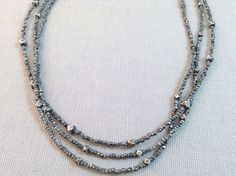 Handmade Silver Necklace with triple strand faceted silver.   Necklace measures 17 inches with 2 inch extension and lobster clasp. Handmade by Evan Knox in her Brown County Studio. All of our jewelry comes boxed and ribboned, ready for giving (or keeping)!