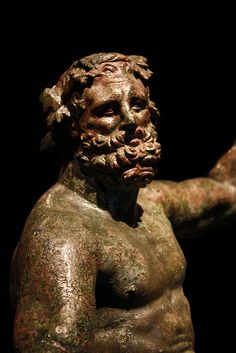 Herakles Epitrapezios. Bronze Hercules with drinking cup. Roman copy of Greek statue by Lysippus. Found in a villa outside Pompeii.
