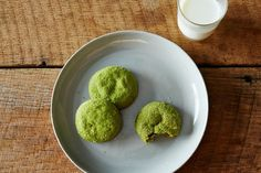 Matcha Snickerdoodles | 2 cups all-purpose flour 3/4 teaspoon baking soda 1/2 teaspoon kosher salt 2 tablespoons plus 1 1/2 teaspoons matcha, divided 1 cup (2 sticks) plus 2 tablespoons unsalted butter, cut into pieces, room temperature 1/2 cup packed light brown sugar 1 1/2 tablespoons honey 1 large egg 1 large egg yolk 2 teaspoons finely grated lemon zest 3 ounces white chocolate, chopped 1/2 cup granulated sugar
