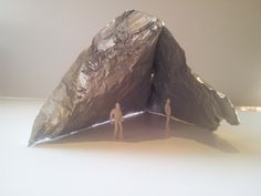 'Shelter' aluminium foil concept model, representing the idea of being sheltered by something in a simple form.