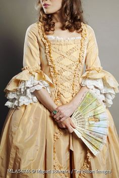 Trevillion Images - historical-woman-in-dress-with-fan
