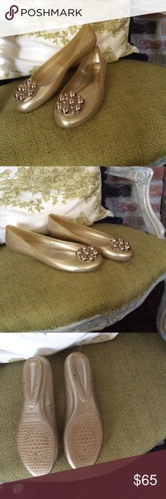 Stuart Weitzman size 8 Gold jelly slip on flat Super cute Stuart Weitzman Gold jelly slip on flats with gold embellishments on the toes. These are a reposh. Loved them but sadly they did not fit. Stuart Weitzman Shoes Flats & Loafers