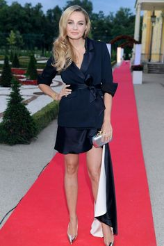 Małgosia Socha wearing Łukasz Jemioł jacket and dress, DVF clutch, Dior heels, earrings and bracelet Tous.