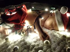 Christmas photo: sleepy 4 month old with high camera ISO, a dark room, and a string of lights= pretty darn cute!