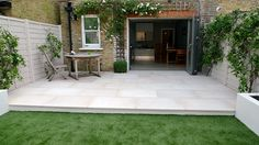beige-sawn-smooth-cut-sandstone-patio-with-easy-grass-lawn-clapham-london.jpg 1,024×573 pixels