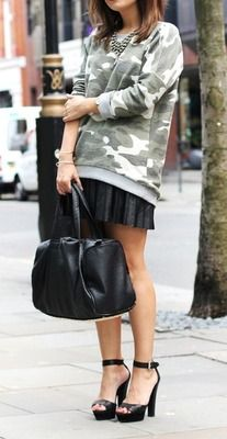 Camouflage Jumper and black leather skirt & bag..