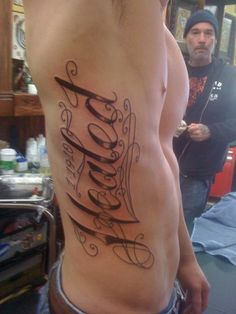 Rib Side cursive writing Tattoos for Men | Healed 1-19-10, rib cage tattoo – Tattoo Picture at CheckoutMyInk ...