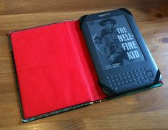 Although I am still anti-electronic reader (I'm a purist!) This would be great for a tablet, no?!   Make your own kindle case out of an old book!