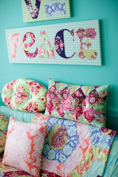 Amy Butler's Love Fabrics with The Oval Patchy Pillows and the Love & Peace wall art - free pattern!