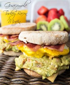 """This Guacamole Turkey Bacon Muffin is a great way to start your day. Loaded with bacon, cheese, and guacamole, its hard to believe something so good can actually be good for you. It steps up the flavor in the everyday """"egg white delight."""" Each mouth watering bite of this Guacamole Turkey Bacon Muffin will be worth every second it took to make. The flavor the turkey bacon and guacamole have together between melted cheese and toasted warm muffin is amazing."""