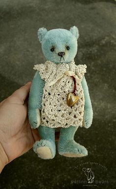 Good Charlotte, OOAK teddy bear girl is constructed in blue colored mohair with merino wool felt pads. Fully jointed with glass eyes and a stitched waxed nose with acrylic gold and varnish added. Standing approx. 8 3/4, 19.5 cm tall. Sse wears a full dress crocheted in a cream