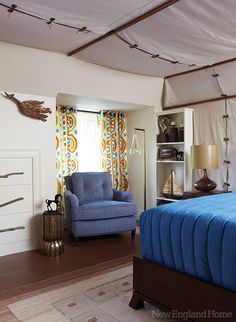 A boy's bedroom with a camping theme by Cynthia Mason Interiors is both plush and adventurous with walls and ceiling of canvas tenting and a mural by artist Patrick Ganino.