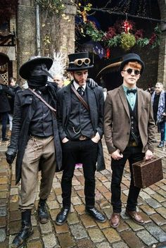 Hipster Steampunks (a plague doctor and 2 well dressed men) fashionable men's steampunk clothing.  - For costume tutorials, clothing guide, fashion inspiration photo gallery, calendar of Steampunk events, & more, visit SteampunkFashionGuide.com
