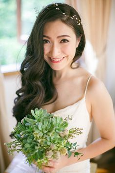 Bride in spaghetti strap wedding gown and succulent bridal bouquet // A Sky Full of Stars: Lee and Yuyu's Wedding at Enderong Resort