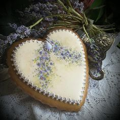 Dainty spring violets hand-painted on a gingerbread heart by Teri Pringle Wood