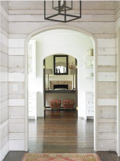 In Good Taste:Carter Kay Interiors - Design Chic - love the wood panels in the entrance foyer and the lantern is gorgeous!