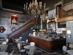 B. Candle-lit chandelier, vintage signs and lots of grey. This edgy bar screams hipster. B...