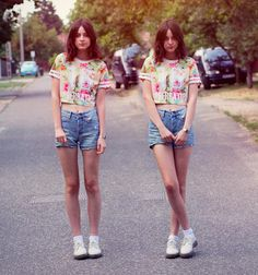 A cute and innocent look that pairs a crop top with high waisted shorts! So 90s!   (by Nory Aradi)
